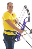 Man holding a bow and arrow Stock Photography