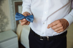 Man holding bow tie. Elegant gentleman clother. Stock Image