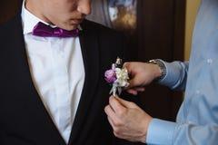 Man holding bow tie. Elegant gentleman clother. Stock Photo