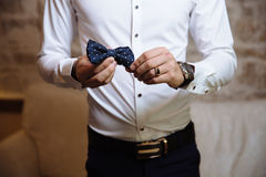 Man holding bow tie. Elegant gentleman clother. Royalty Free Stock Photography