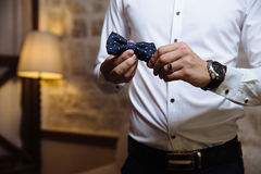 Man holding bow tie. Elegant gentleman clother. Royalty Free Stock Image