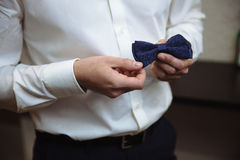 Man holding bow tie. Elegant gentleman clother. Royalty Free Stock Photo