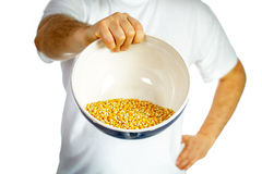 Man holding a bowl of corn Royalty Free Stock Photo