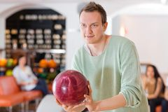 Man Holding Bowling Ball in Club Stock Photography