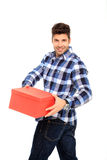 Man holding a box. Handsome man portrait with a red box in his hands Royalty Free Stock Photography