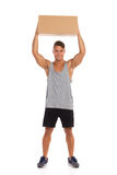 Man Holding Box Above His Head Royalty Free Stock Images