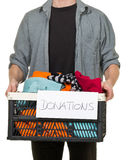 Man holding box with clothing donations Stock Photography