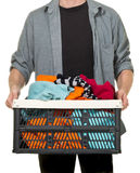 Man holding box with clothing donations Royalty Free Stock Image