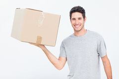 Man holding a box with one hand Stock Photos