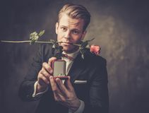 Man holding box with a proposal ring Royalty Free Stock Photo