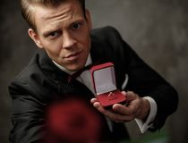 Man holding box with a proposal ring Royalty Free Stock Images
