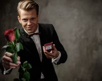 Man holding box with a proposal ring Royalty Free Stock Photos