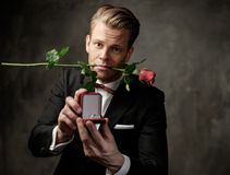 Man holding box with a proposal ring Royalty Free Stock Photography