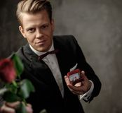 Man holding box with a proposal ring Royalty Free Stock Image