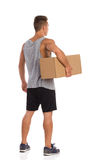 Man Holding Box Under His Arm. Back Side View Royalty Free Stock Image
