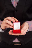 Man holding box with wedding ring Royalty Free Stock Image