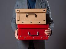 Man holding boxes. Stock Image