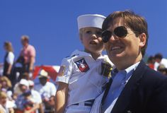 Man Holding Boy Dressed As Sailor Stock Image