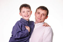 Man holding a son. Man holding a boy on a white background Stock Photos