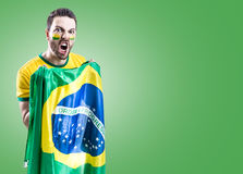 Man holding the Brazilian flag on green background Stock Photography