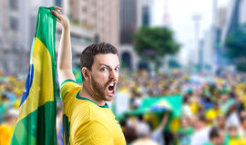 Man holding the Brazilian flag in Sao Paulo, Brazil Stock Photography