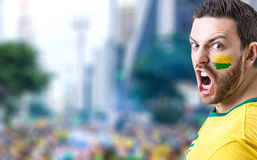 Man holding the Brazilian flag in Sao Paulo, Brazil Stock Photos