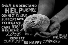 Man holding bread with both hands, helping hands giving bread. Word cloud. Black and white. Man holding bread with both hands surrounded by random beautiful stock image