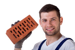 Man holding brick Stock Photography