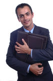 Man holding a briefcase. A young business man holding a briefcase in a white background Royalty Free Stock Image