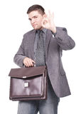 Man holding a briefcase and making ok sign Stock Images