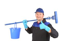 Man holding broom and bucket. Royalty Free Stock Photography