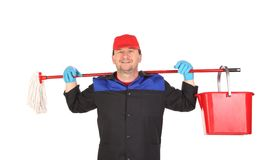 Man holding broom and bucket. Stock Image