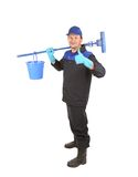 Man holding broom and bucket. Royalty Free Stock Photos