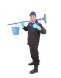 Man holding broom and bucket. Royalty Free Stock Photos