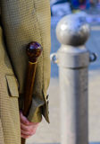 Man holding a brown walking stick Royalty Free Stock Images