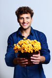 Man holding bucket with flowers Stock Photography
