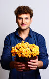 Man holding bucket with flowers Stock Photo