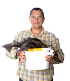 Man holding a bucket with fresh fish - trout in the hands of Stock Photography