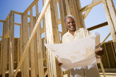 Man Holding Building Plans Stock Photo
