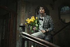 man holding bunch of flowers Stock Image