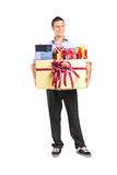 Man holding a bunch of presents Stock Image