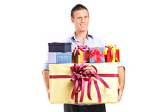 Man holding a bunch of presents Stock Photography