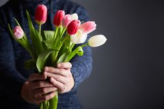 A Man holding bunch of tulips royalty free stock images