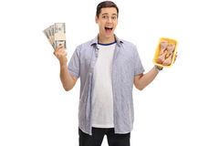Man holding bundles of money and chicken drums Royalty Free Stock Photo