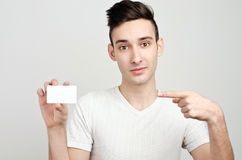 Man holding a business card. Royalty Free Stock Photography