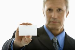 Man holding business card. Royalty Free Stock Photography