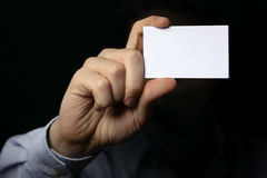 Man holding business card. Close up shot Stock Photos