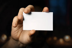 Man holding business card. Close up shot Stock Images