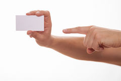 Man holding a business card and indicating it Stock Photos