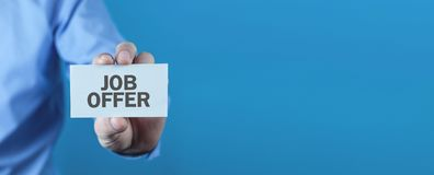 Man holding business card. Job offer royalty free stock photography